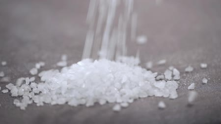 taneli : Welsh sea salt flakes on dark background. Close up of minerals droping