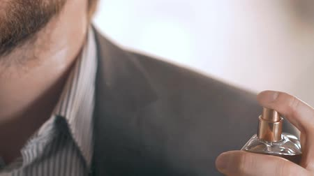 eau : close up of handsome young business man using perfume Stock Footage