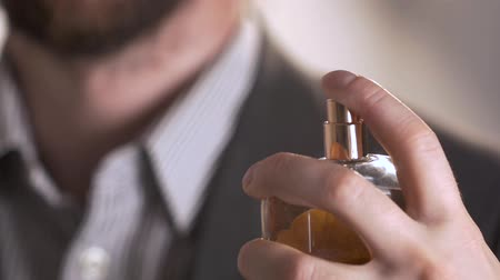 perfume bottle : close up of handsome young business man using perfume Stock Footage