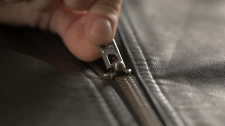tecido : close up Opened zipper on man leather jacket