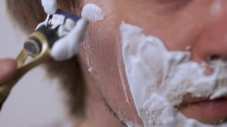 barbear : Man shaves shaving foam on a white background