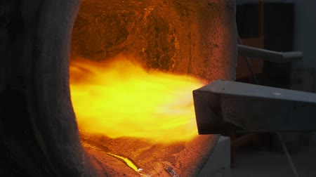 benzin : hot steel burned by modern burner. Red hot metal with fire