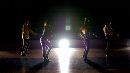 breakdancing : Silhouettes of dancers posing with classical and modern hip hop dance. Dance on basketball arena Stock Footage
