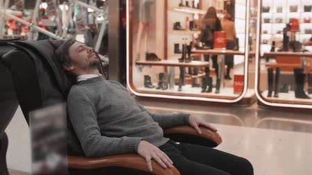 Man in shopping mall lay in massage chair close up shot