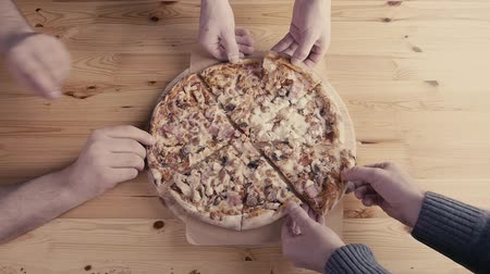 peperoni : Close-up Of People Hands Taking Slices Pizza from food delivery. Tasty Service to office Stock Footage