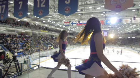faceoff : Girls cheerleaders perform on hockey game, Nizhny Novgorod, 14 november 2016, torpedo-salavat ulaev.