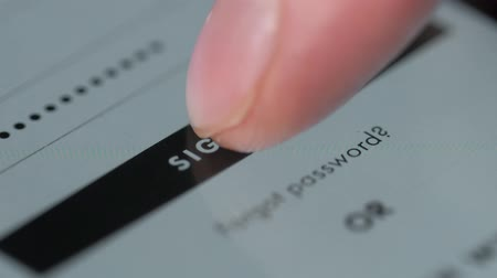 website : Close-up of a sign in button and hand touch screen on tablet or phone Stock Footage