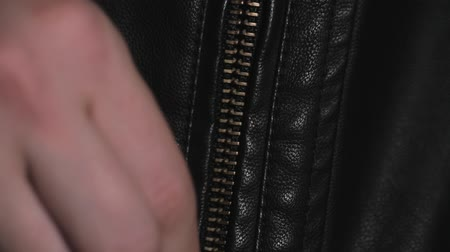 tecido : close up Opened zipper on man leather jacket macro Vídeos
