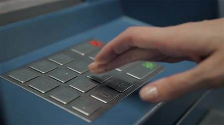 capital punishment : Atm machine close up hand entering pin number. Close up of the hand of woman pushing buttons for money cah in out, entering the pin number at the atm machine. Stock Footage