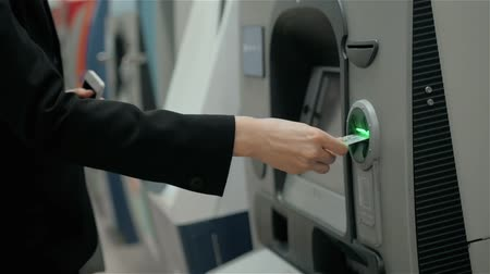 öz : young woman inserting a credit card to ATM, beautiful girl banking, business woman after work in bank, shopping mall