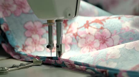 yorgan : process of quilting on patchwork blanket close up sewing machine hands production