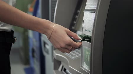 bankomat : Close up of hand of a woman using banking machine, atm withdrawal with credit card business, dollar euro