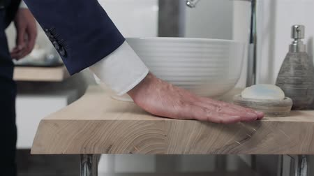 dobras : hands choosing in bathroom salon. Close up of hand touch new furniture Vídeos
