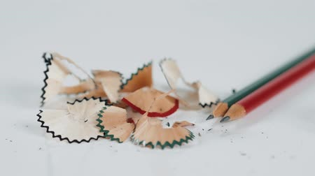 bilenmiş : Wooden colorful pencils with sharpening shavings, on white background close up studio macro Stok Video