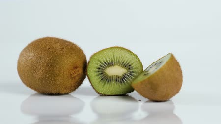 healthyfood : Close up kiwi fruit cut in half macro studio Stock Footage