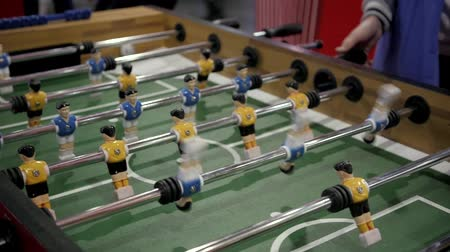Handsome cheerful men having fun on event playing table soccer close up sport competition contest football Stok Video
