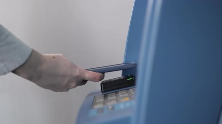 transmitir : withdrawing money from atm with a mobile phone a NFC terminal office shopping mall terminal airport close up Vídeos
