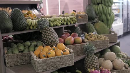 нектарин : Colorful fruit stand in a local market pineapple, mango, passion fruit asia Стоковые видеозаписи