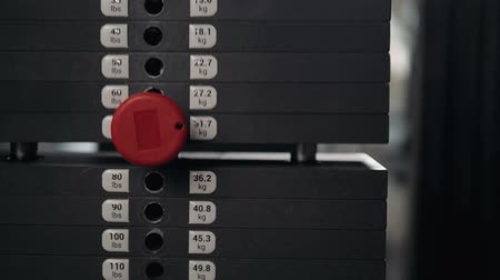 apparatus : Close up plate stacked of weight machine with kilogram and pound number at fitness gym macro super closeup