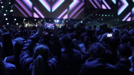 megvilágított : People taking photographs with touch smart phone during a music concert live on stage for the Ace of Heart tour at Sports arena