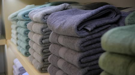 yumuşaklık : colored towels on the store shelf close up macro