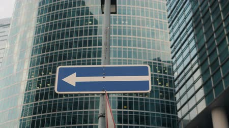 pole street : Empty one-way sign against blue sky city office skyscrappers