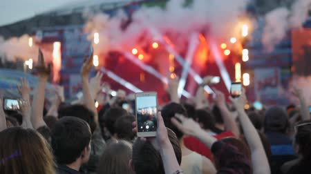 concert crowd : Rear view of festival crowd raising their hands. Open air concert hip hop rap music students Stock Footage
