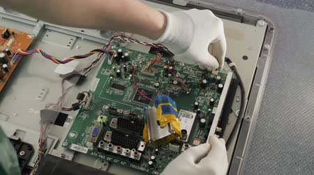 düzeltme : Technician repairing a television. Hand with voltmeter above board with components. Repair of circuits electric equipment, close up