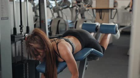 planking : Fit girl in gym doing plank exercise for back spine and posture Concept pilates fitness sport indoor athlete ass woman sexy horizontal lie