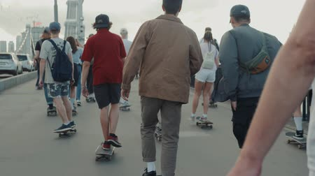 bin : 21 June, Moscow, Russia, Go skateboarding day, crowd skaters, young professionals and amateur athlete boy is drive on skateboard, eco transportation, city streets, happy students drive on boards and longboards and doing tricks
