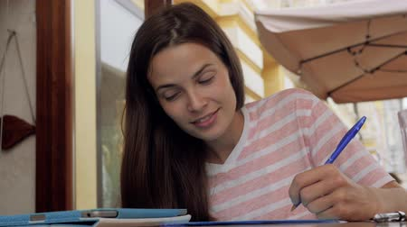 literatura : Young woman studying sitting in cafe student girl homework