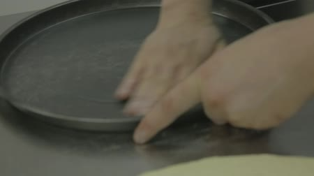 barbecue set : the cook pours oil and distribute it in a frying pan