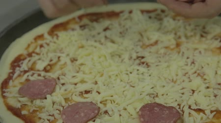 salame : Chef add sausage to pizza