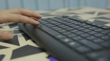 vstup : Female office worker typing on the keyboard