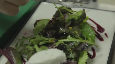 healthyfood : Classic Greek salad from tomatoes, cucumbers, red pepper, onion with olives, oregano and feta cheese. beet Stock Footage