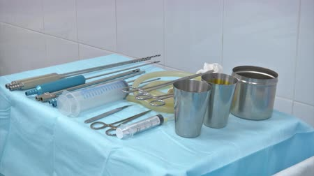 clean room : surgical instruments and tools including scalpels, forceps and tweezers arranged on a table for a surgery
