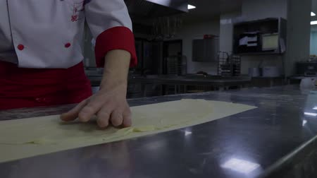 knead : the Baker cuts the dough