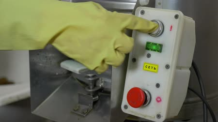 rind : The man presses the button to turn on the potato cleaner Stock Footage