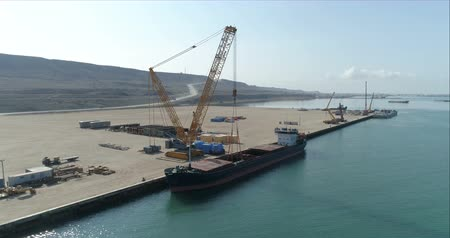 visão global : 4K Aerial video filming of a container ship fixed in the port of Bautino on the shores of the Caspian Sea, Kazakhstan