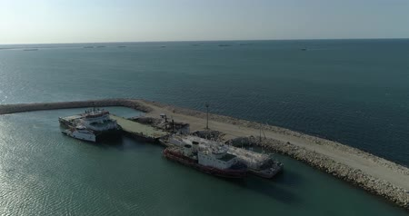 visão global : 4K Aerial video filming of a container ships fixed in the port of Bautino on the shores of the Caspian Sea, Kazakhstan