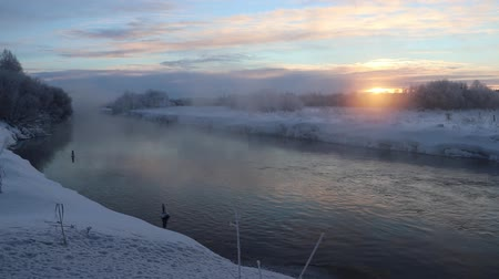 Скандинавия : Morning Dawn Evaporation from water in bitter cold. River video and evaporation at sunrise