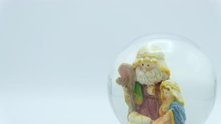 jesus born : Christmas nativity scene inside glass ball on white background. Footage ready to loop. Left copy space. Stock Footage