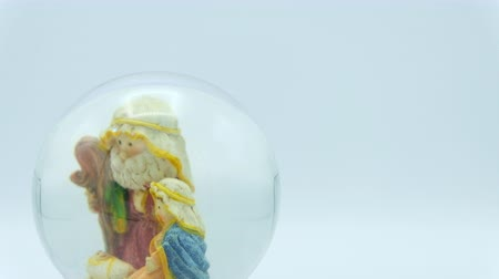jesus born : Christmas nativity scene inside glass ball on white background. Footage ready to loop. Right copy space. Stock Footage