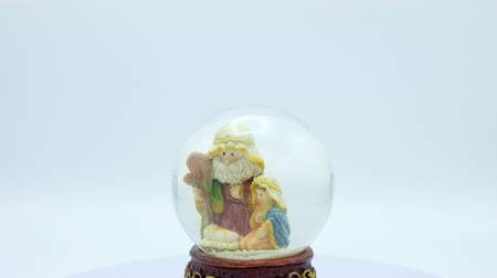 jesus born : Christmas nativity scene inside glass ball on white background. Footage ready to loop. Centered.