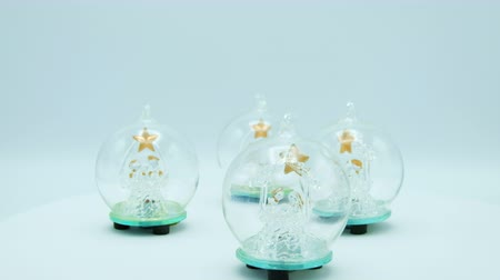 sfera di cristallo : Glass balls with Christmas tree and golden star ready to loop footage isolated on white background.