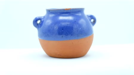 terrakotta : Christian Nativity Scene in a small terracotta blue and brown vase. Footage ready for loop.