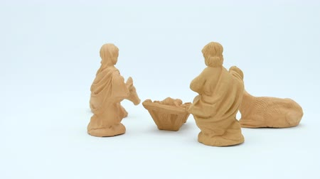 jesus born : Terracotta Christian Nativity Scene on white background. Footage ready for loop. Stock Footage