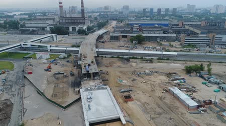 Construction of roads and buildings. Aerial video shooting.