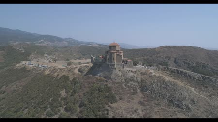 View of the beautiful Dreni monastery Jvari from a height. Aerial video in Georgia.