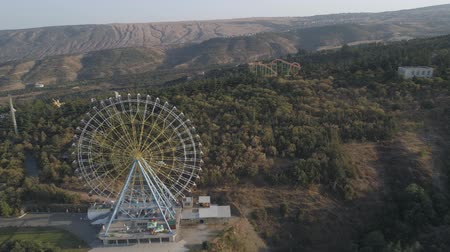 View of the ferris wheel in the park Mtatsminda in Tbilisi. Aerial video shooting.